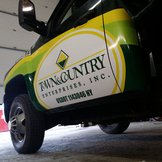 TOWN & COUNTRY PARTIAL WRAP BY ENVISION GRAPHICS, ROCHESTER, NY.jpg...